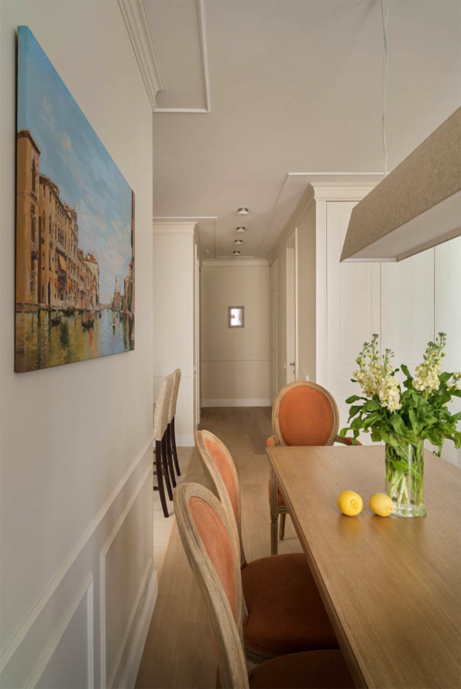 0-beige-interior-traditional-style-open-plan-dining-room-area-wooden-table-upholstered-terracotta-chairs-wall-art-Italy-landscape-painting-flowers