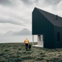 0-cheaper-alternatives-to-living-in-a-house-flat-pack-wooden-house-on-the-sea-shore