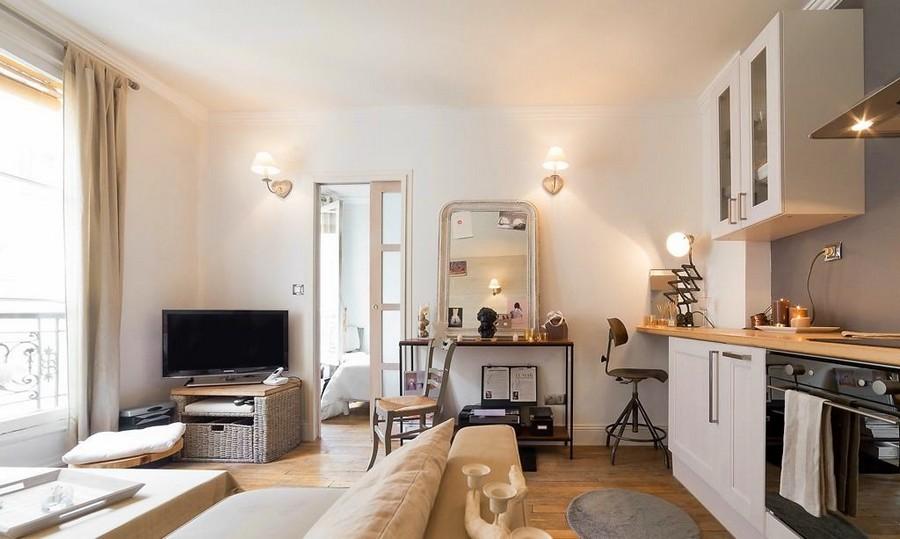 1-2-white-walls-beige-gray-caramel-brown-interior-design-in-French-style-Paris-studio-apartment-kitchen-living-room-boudoir-dressing-table-mirror-cabinets-sofa-TV-set-wicker-basket-sliding-door