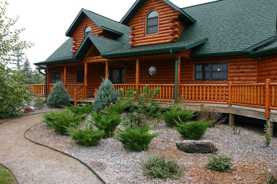 1-cheaper-alternatives-to-living-in-a-house-log-house-big-timber-house-with-green-roof