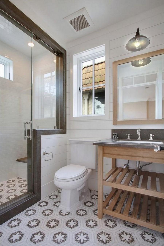 1-clean-tidy-neat-traditiobal-style-bathroom-interior-design-light-wooden-vanity-unit-wooden-planks-mirror-frame-white-walls-glass-walk-in-shower-WC-toilet-window-extraction-fan-hexagonal-floor-tiles-light