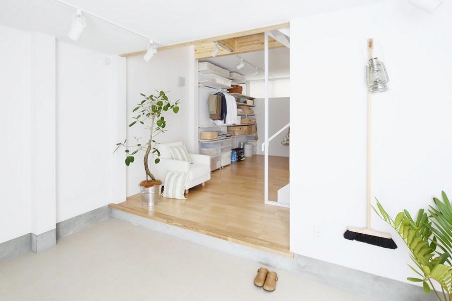 1-minimalist-style-interior-white-walls-light-wood-floor-furniture-Scandinavian-style-pantry-walk-in-closet-storage-area-lantern-mop-indoor-plant-in-a-bucket