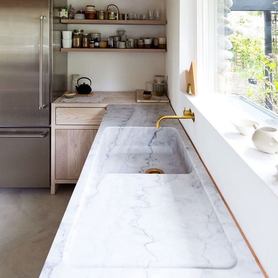 1-white-marble-natural-stone-kitchen-wokrtop-countertop-monolitic-sink-retro-style-brass-wall-mounted-water-tap-faucet-open-wooden-racks-cabinets-gray-metal-refrigerator