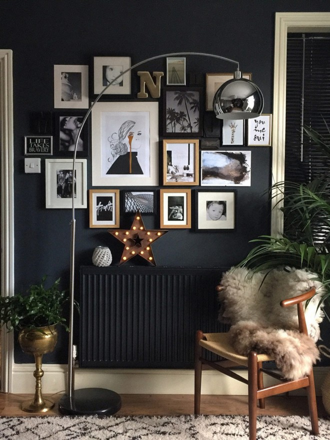 12-black-walls-black-walled-room-in-interior-design-living-room-painted-radiator-metal-floor-lamp-wooden-arm-chair-with-fur-cushion