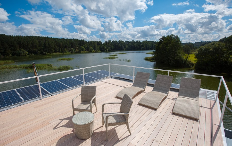 14-houseboat-float-house-exterior-design-light-laminate-larch-wood-floor-solar-panels-batteries-outdoor-furniture-sunbathing-upper-top-deck-chairs-coffee-table-chaise-lounges