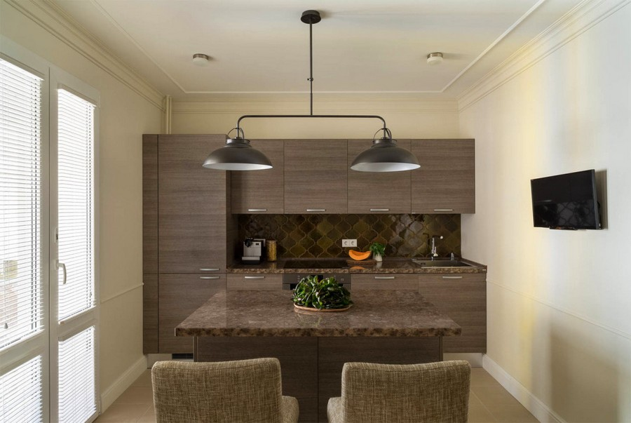 2-2-beige-interior-traditional-style-open-plan-kitchen-light-walls-milk-chocolate-brown-cabinets-island-by-Scavolini-upholstered-bar-stools-caramel-brown-backsplash-balcony-exit-black-lamp-TV-set