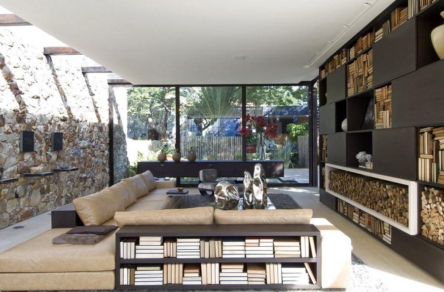 2-5-shelves-decoration-of-bookshelves-decor-ideas-overturned-fore-edges-living-room-fireplace-stone-wall-firewood-beige-corner-sofa