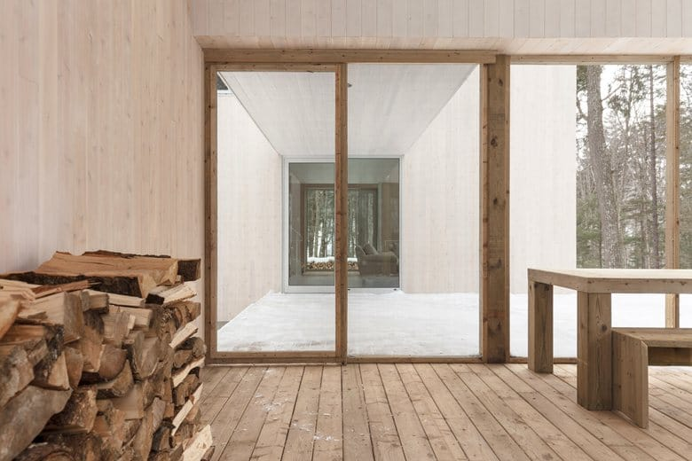 2-studio-fire-wood-minimalist-style-house-interior-terrace-in-the-wood-winter-wooden-table-panoramic-windows