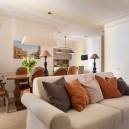 3-1-beige-interior-traditional-style-open-plan-kitchen-living-dining-room-white-sofa-terracotta-orange-chairs-throw-couch-pillows-table-lamps-air-conditioner-painting-light-parquet-floor