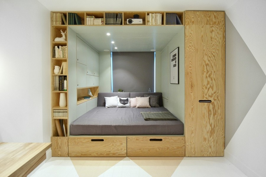 3-1-teenage-girl's-room-bedroom-interior-design-multifunctional-podium-bed-white-walls-plywood-veneer-furniture-gray-accents-built-in-shelves-wardrobe-storage-area-around-bed-roman-blinds