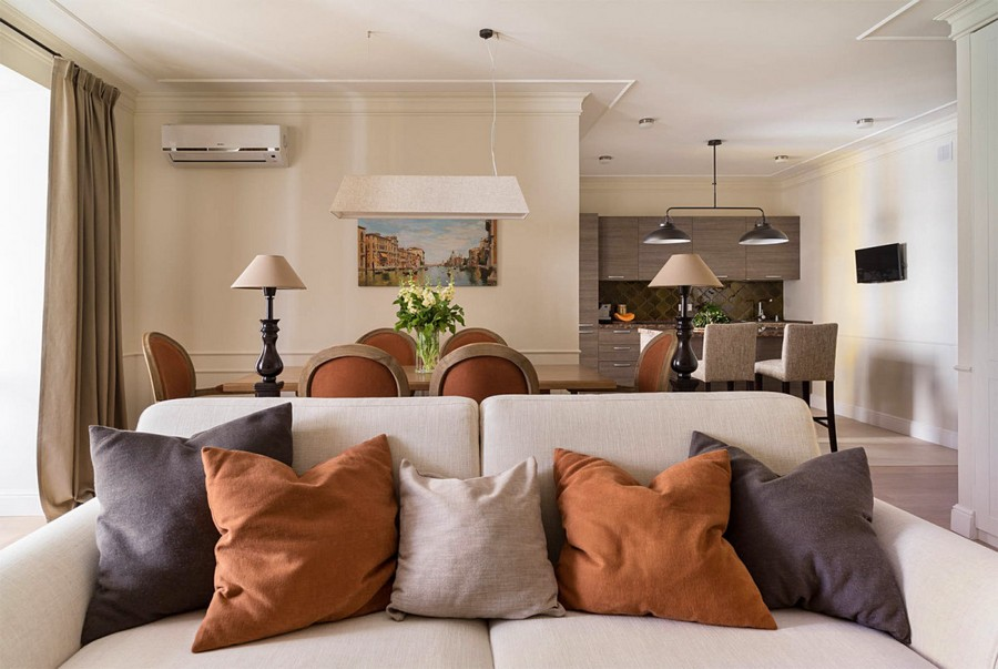 3-2-beige-interior-traditional-style-open-plan-kitchen-living-dining-room-white-sofa-terracotta-orange-chairs-throw-couch-pillows-table-lamps-air-conditioner-painting-light-parquet-floor