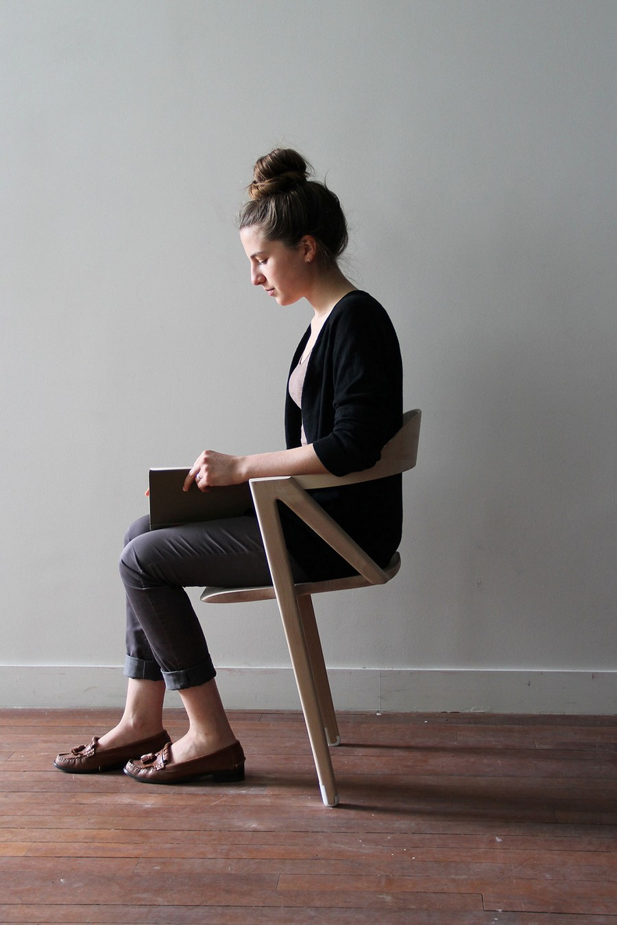3-2-inactivite-by-benoit-malta-chair-on-two-legs-light-wood-inconvenient-design-of-office-chair