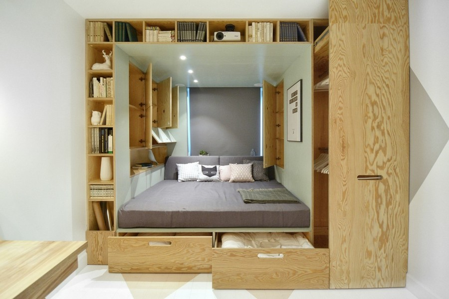 3-2-teenage-girl's-room-bedroom-interior-design-multifunctional-podium-bed-white-walls-plywood-veneer-furniture-gray-accents-built-in-shelves-wardrobe-storage-area-around-bed-roman-blinds-drawers-cabinets