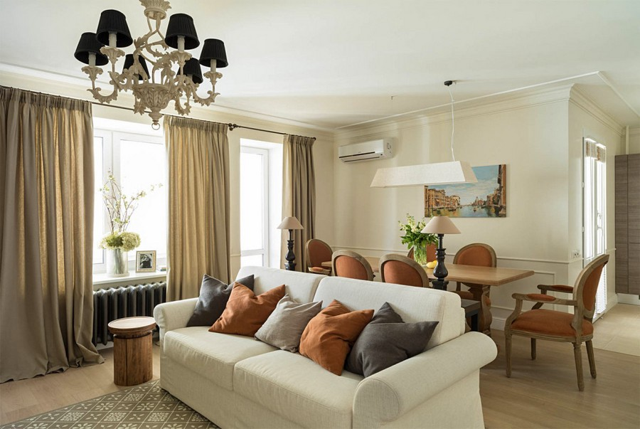 4-2-beige-interior-traditional-style-open-plan-kitchen-living-dining-room-white-sofa-terracotta-orange-chairs-throw-couch-pillows-table-lamps-air-conditioner-painting-light-parquet-floor