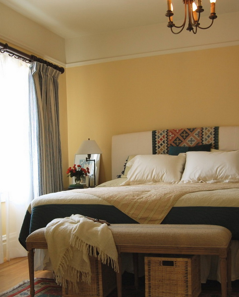 4-3-symmetrical-decor-symmetry-in-interior-design-bedroom-beige-walls-brown-accents-curtans-bedside-bench-plaid-blanket-home-textile-nightstand-lamp-flowers