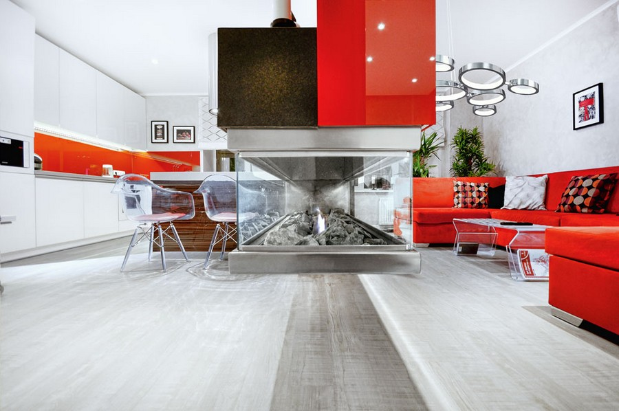 4-bio-fireplace-in-glass-display-window-between-living-room-kitchen-white-and-red-interior-design-double-sided-room-divider-gray-floor-transparent-plastic-chairs-coffee-table