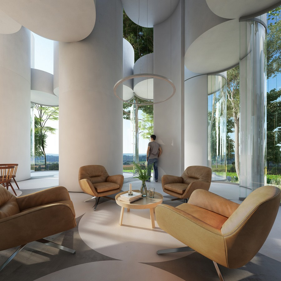 4-cylinder-house-by-Cyril-Lancelin-modular-residential-architecture-in-France-Lyon-open-plan-living-room-lounge-forest-view-round-coffee-table-laconic-interior-arm-chairs