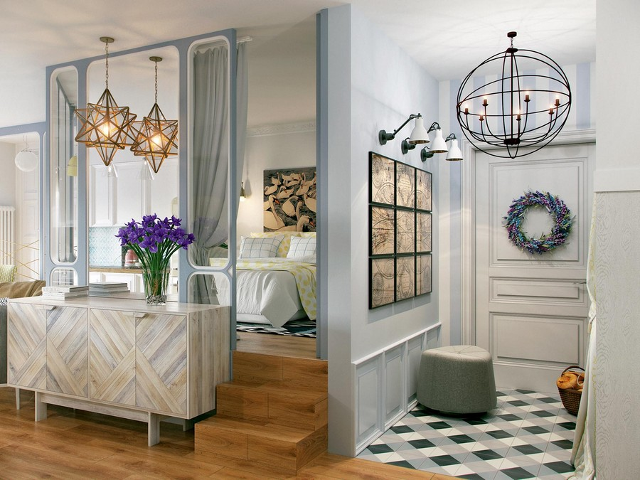4-entrance-hall-hallway-mudroom-open-to-living-room-ceramic-floor-tiles-geometrical-light-interior-gray-beige-white-walls-chandelier-door-wreath-wall-art-lamps-chest-of-drawers-with-herrigbone-pattern-mirrored-wall-podium