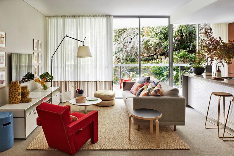 5-1-living-room-interior-design-carpet-rug-beige-gray-sofa-red-arm-chair-blue-floor-lamp-island-bar-stools-panoramic-windows-ottomans-coffee-tables