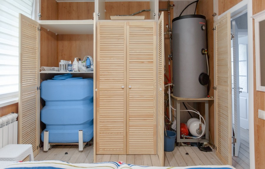 5-2-houseboat-float-house-interior-design-in-nautical-style-light-laminate-walls-larch-wood-floor-light-blue-accents-utility-closet-pantry-with-water-tank-heating-boiler