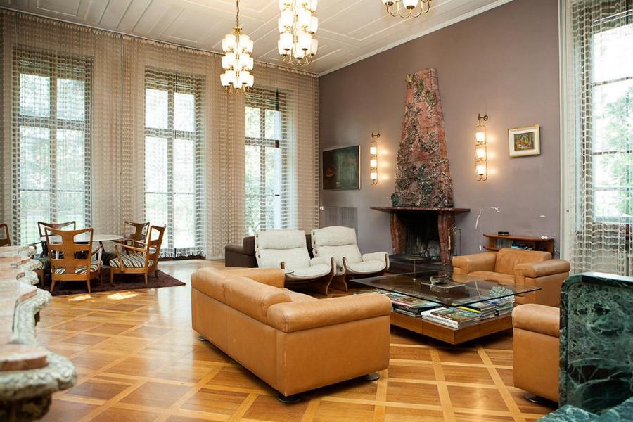 5-Italian-villa-interior-design-by-Osvaldo-Borsani-living-room-lounge-in-art-deco-style-rectangular-leather-sofas-fireplace-luxurious-ceramic-glazed-tiles-natural-stone-arm-chairs-dining-area