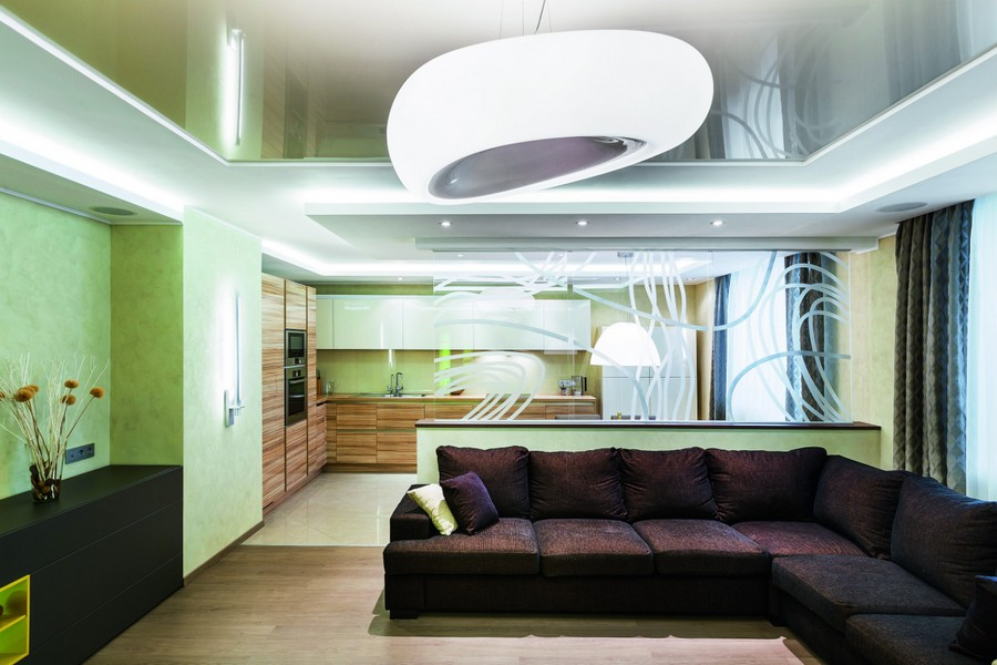 5-green-purple-open-plan-living-room-kitchen-white-cabinets-corner-sofa-tempered-glass-wall-partition-room-divider-with-abstract-pattern-big-futuristic-chandelier-lamp-spot-lights