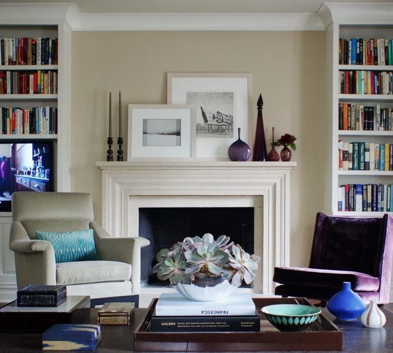 6-1-symmetrical-decor-symmetry-in-interior-design-bookshelves-home-library-living-room-arm-chairs-fireplace-artworks-coffee-table-candles-books