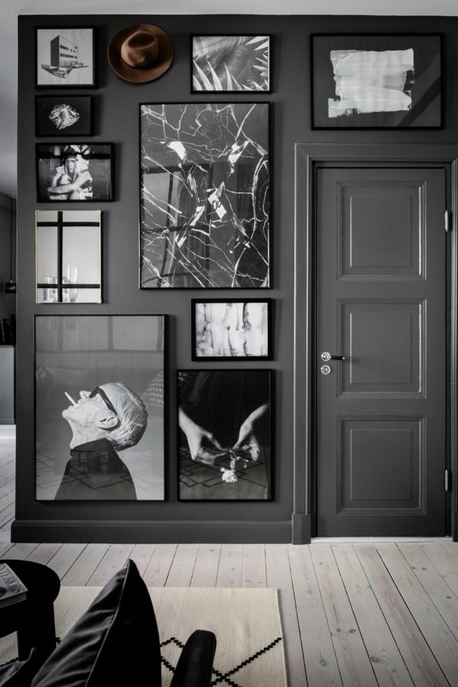 6-black-walls-black-walled-room-in-interior-design-mudroom-hallway-entrance-hall-room-black-and-white-wall-art-photo-gallery-wooden-floor