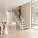 6-light-wood-house-interior-in-the-wood-Canada-panoramic-windows-light-airy-white-kitchen-dining-room-minimalist-ascetic-winter-forest-view-fire-wood