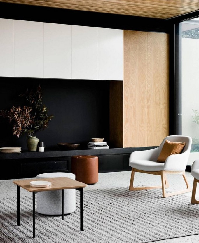 7-2-MDF-panels-boards-in-interior-design-built-in-closet-doors-white-ceiling-cabinets-living-room-black-and-white-arm-chair-coffee-table