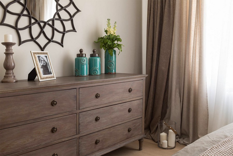 7-2-beige-interior-traditional-style-bedroom-white-built-in-closet-chocolate-brown-chest-of-drawers-beautiful-mirror-candles-decor-photo-frame