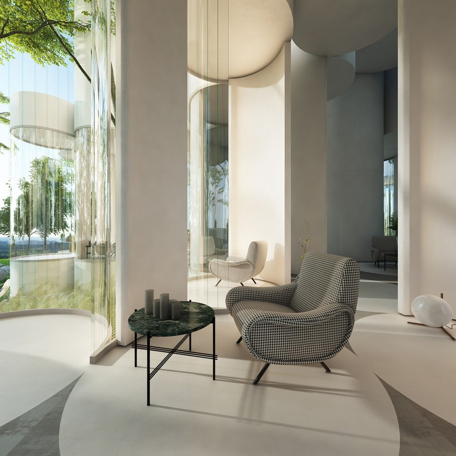8-cylinder-house-by-Cyril-Lancelin-modular-residential-architecture-in-France-Lyon-open-plan-lounge-zone-forest-view-round-coffee-table-laconic-interior-arm-chair