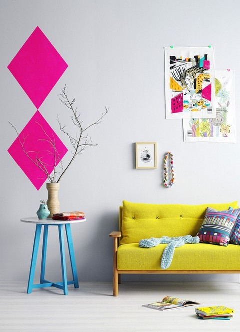 0-how-to-add-bright-color-to-home-interior-white-walls-art-decor-blue-pink-mustard-yellow-sofa-couch-pillows-posters-coffee-table-living-room