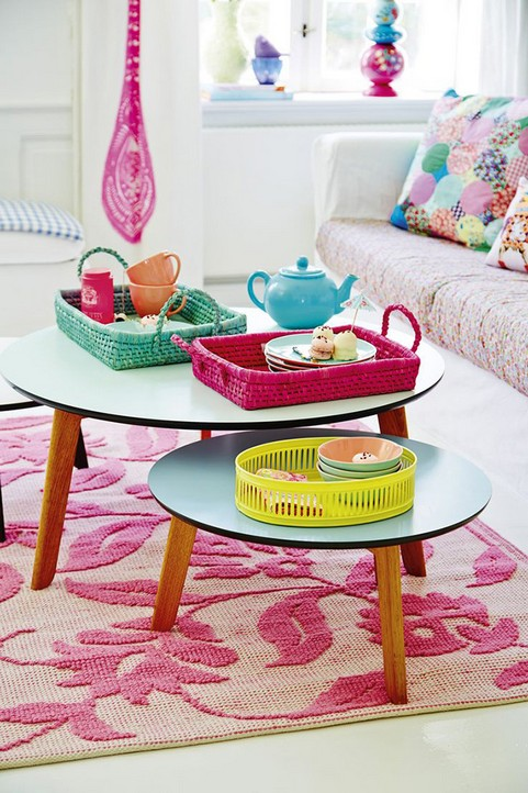 1-how-to-add-bright-color-to-home-interior-living-room-two-coffee-tables-double-pink-blue-yellow-rugs-sofa-couch-trays-tea-pot-basket