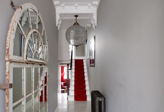 1-narrow-hallway-decoration-decor-interior-design-white-walls-mirror-mosaic-chandelier-red-staircase