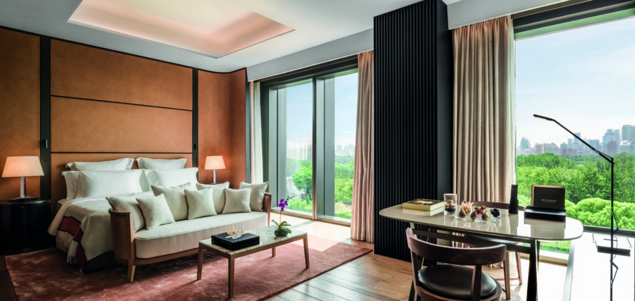 5-3-Bvlgari-hotel-beijing-luxurious-interior-design-China-bedroom-suite-panoramic-windows-Italian-style-contemporary-bed-couch-pillows-office-desk-laptop