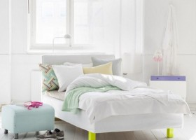 8-how-to-add-bright-color-to-home-interior-bedroom-white-walls-white-wooden-floor-neutral-scandinavian-style-colors-pastel-blue-ottoman-geometrical-pillow-yellow-bed-furniture-legs