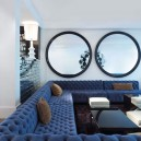 0-big-round-mirror-in-interior-design-home-decor-living-room-lounge-big-blue-capitone-sofa-white-walls-coffee-table