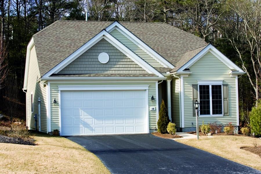 0-garage-door-white-small-country-house-driveway-lantern-light