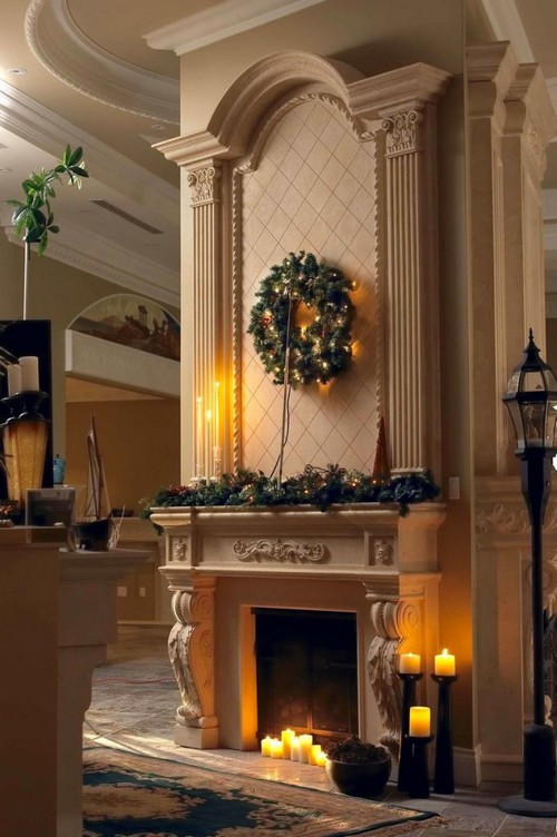 1-2-wood-burning-fireplace-ideas-decoration-in-interior-design-concrete-finishing-classical-style-high-ceiling-Christmas-decorations-wreath-candles-columns-plaster