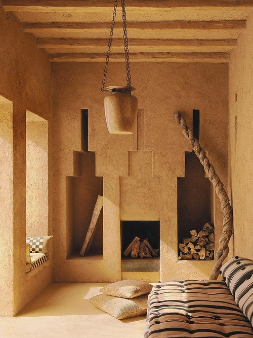 1-7-wood-burning-fireplace-ideas-decoration-in-interior-design-concrete-finishing-in-oriental-style-wall-recesses-niches-for-storing-log-fire-bowl-lamp-pillows-beige-walls-ethnic-motifs
