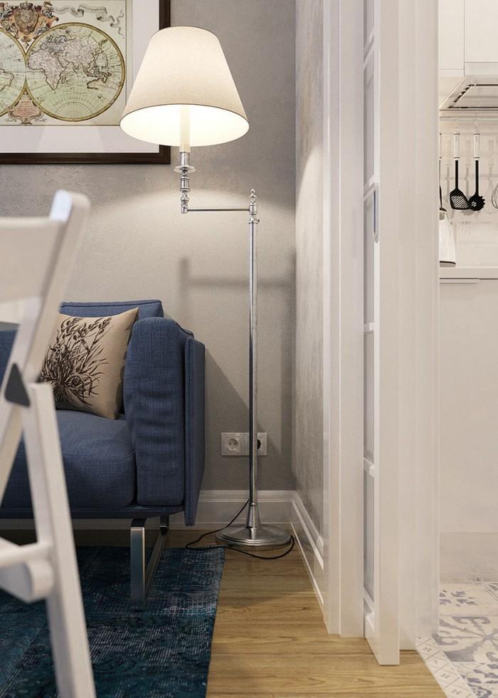 7-1-light-grayish-blue-studio-apartment-interior-design-in-modern-style-floor-lamp-by-Bella-Figura-SL14-with-rotating-arm-rod-blue-sofa-carpet