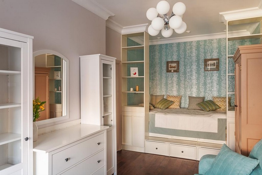 2-2-podium-bed-platform-in-interior-design-peppermint-blue-and-white-girl's-room-bedroom-white-furniture-see-through-shelves-chest-of-drawers-sofa-many-storage-areas