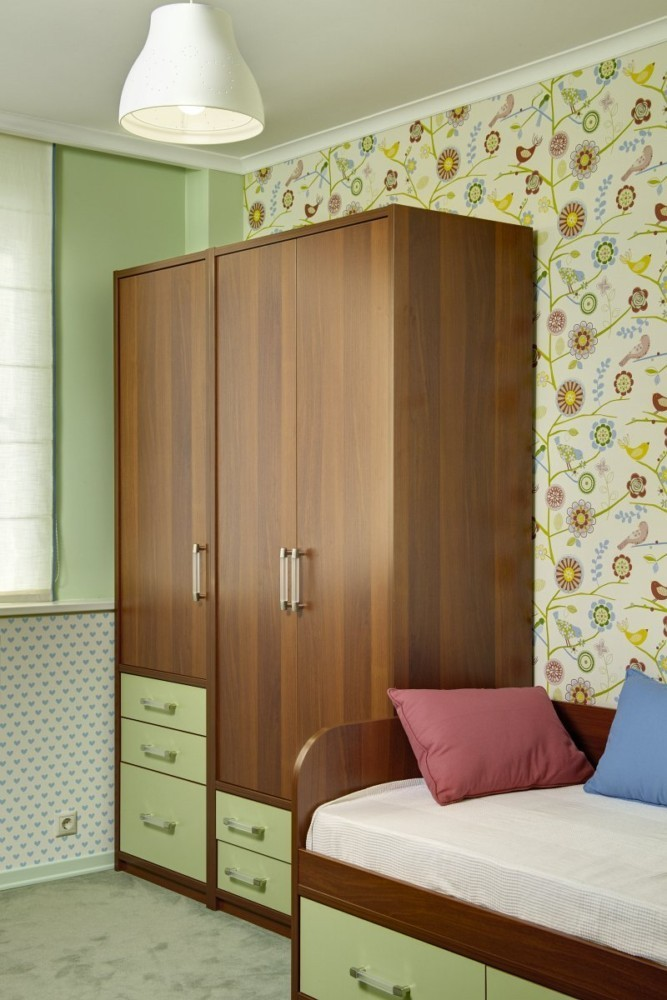 7-girls-room-interior-design-green-pink-bright-floral-wallpaper-Yet-Jet-collection-by-Prestigious-Wallcovering-bicolor-wardrobe-sofa-lamp